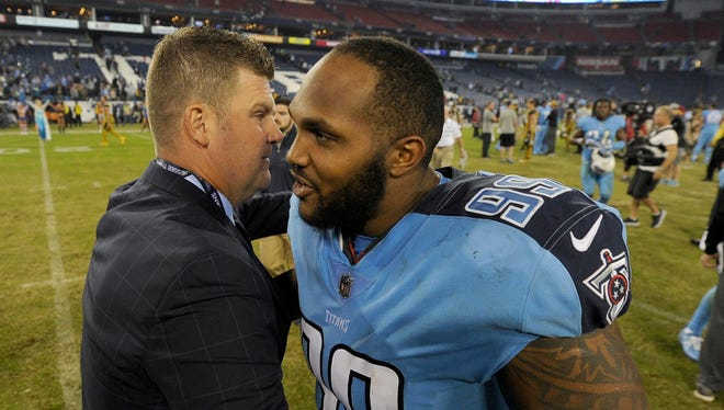 Titans General Manager Jon Robinson hugs Titans defensive end Jurrell Casey (99) after the Titans 36-22 win over the Jags at Nissan Stadium Thursday, Oct. 27, 2016, in Nashville, Tenn.