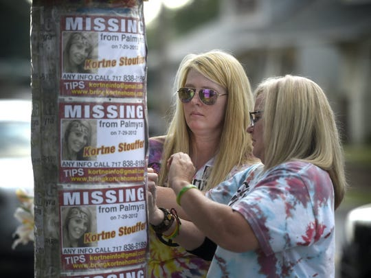 The family and friends of Kortne Stouffer,  who disappeared from her apartment at 810 W. Main St., Palmyra, on Sunday, July 29, 2012, gather in front of the house on the third anniversary of her disappearance. Anyone with information about Stouffer's disappearance is asked contact Detective Mike Dipalo, the head investigator on the case, at the Lebanon County District Attorney's office, 717-228-4403, or private investigator Leah Jennings, at 717-348-3205.
