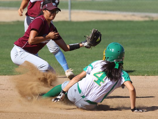 Coachella Valley High School's Vanessa Madera slides safely into second base after hitting a double against Rancho Mirage High School in Thermal on April 5, 2017.