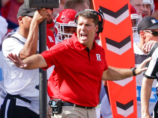 Rutgers head coach Chris Ash calls a time out during the first half of an NCAA college football game against Nebraska in Lincoln, Neb., Saturday, Sept. 23, 2017. (AP Photo/Nati Harnik)
