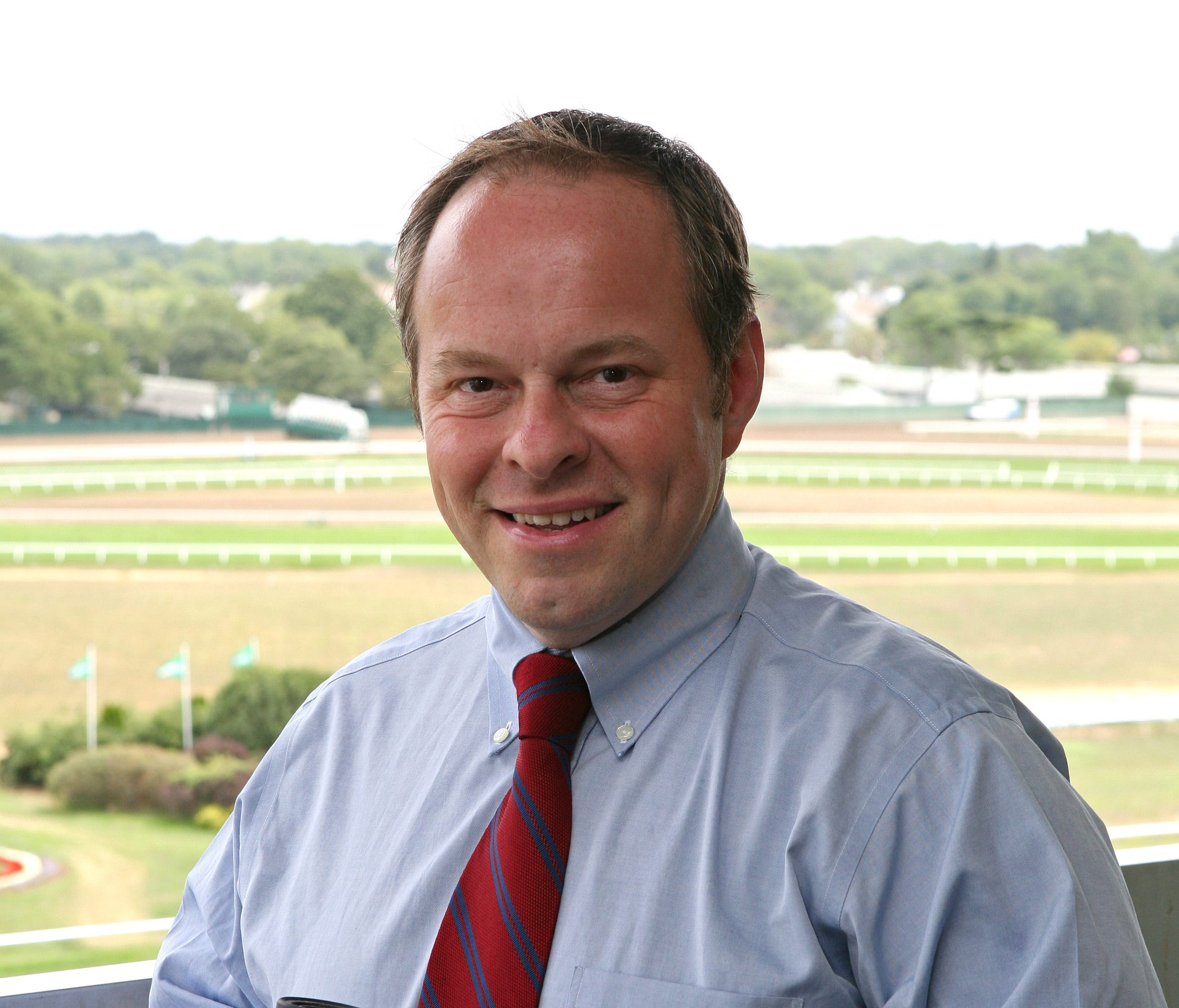 Larry Collmus poses for a portrait at Monmouth Park race course in Oceanport, N.J., in a file photo from 2010.