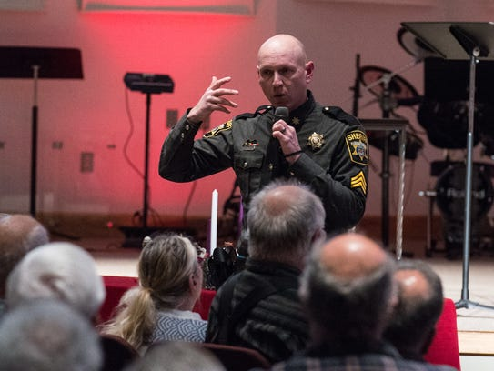 Wicomico County Sheriff's deputy Sgt. Benson Propst speaks to an audience at Allen Memorial Baptist Church during an active shooter training session Wednesday.