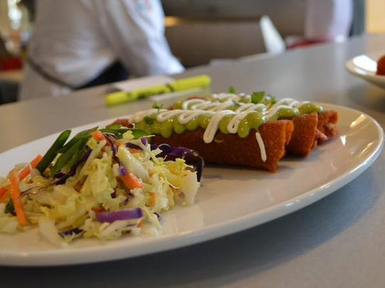 Chipotle enchiladas topped with salsa verde are a regular menu item at The Cider Press Cafe in Naples.