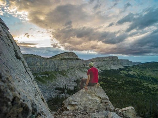 Chris Peterson sits at the Chinese Wall in the Bob Marshall Wilderness.