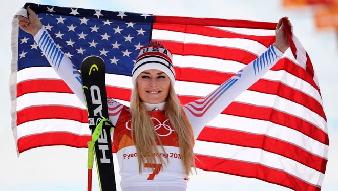 Lindsey Vonn celebrates winning the bronze medal in the Alpine skiing downhill event at the Olympics in February.