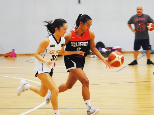 Kali Benavente takes the ball downcourt while defended by Chloe Miranda during Guam's women's national basketball team practice on June 14, 2018 at the Guam Basketball National Training Center in Tiyan.