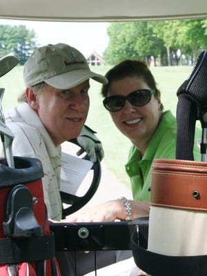 Rotarian Jim Gelhar and his wife Pat Grahn participate in a past Rotary Golf Outing.