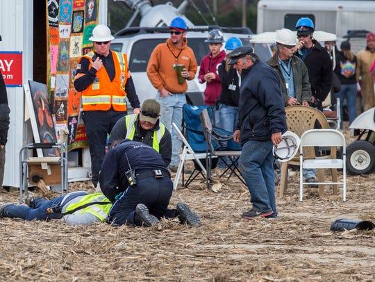 Paramedics tend to an injured person after a piece