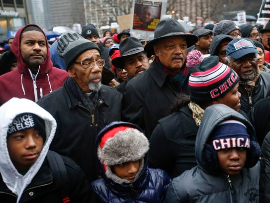 Civil rights activist Jesse Jackson (2-R) walks with
