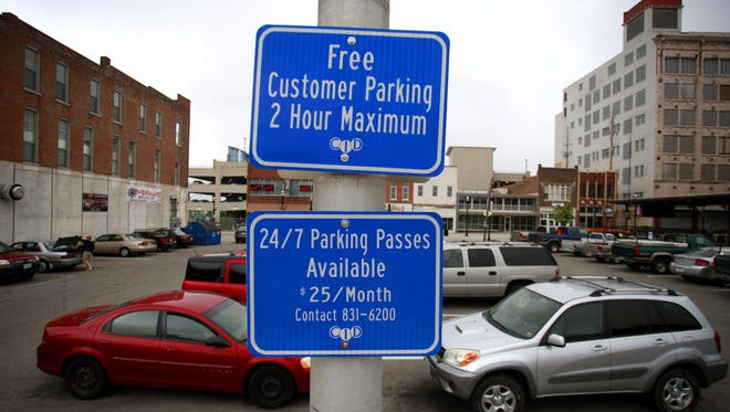 A popular downtown lot that has for years allowed free two-hour parking will be off limits to the general public come October.