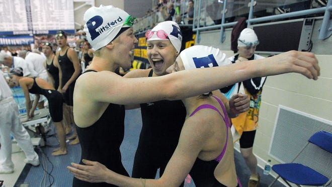 Pittsford relay swimmers Lindsay Stone, left, Emma Corby and Becca Evans celebrate their win in the 2014 finals of the 400 yard freestyle relay during the state meet at Ithaca College.