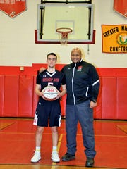 Senior Alex Santiago, achieved the 1,000-point milestone, pictured with Head Boys Basketball Coach Ron James.