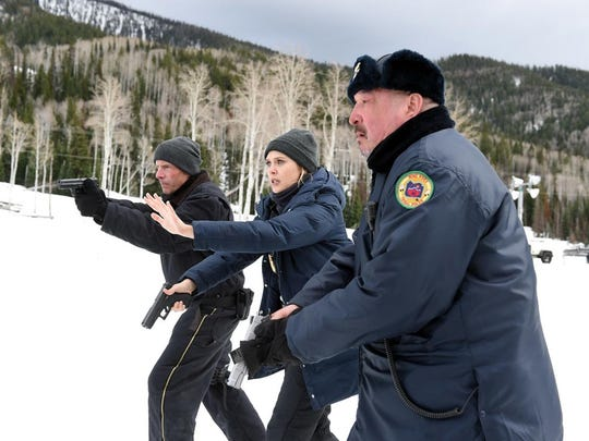 "Hugh Dillon, Elizabeth Olsen and Graham Greene star in ""Wind River."""