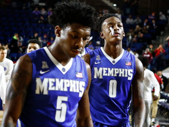 University of Memphis teammates Kareem Brewton Jr. (left) and Kyvon Davenport (right) walkout the court after falling to University of Alabama 82-70 at the Veterans Classic in Annapolis, Md., Friday, November 10, 2017.