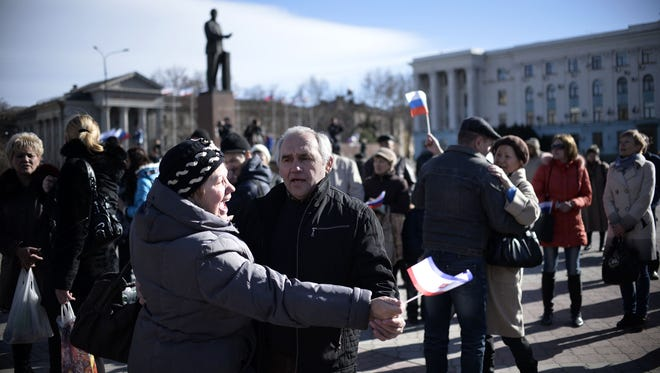 People dance in Simferopol's Lenin Square on March 17. Crimea declared independence from Ukraine and applied to join Russia.