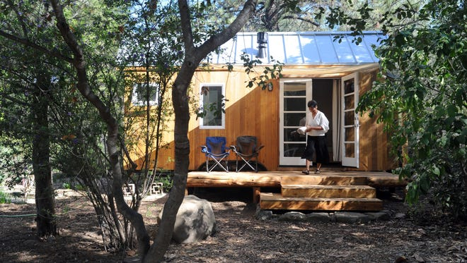 Vina Lustado of Ojai walks into her tiny house in this photo shot in 2014.