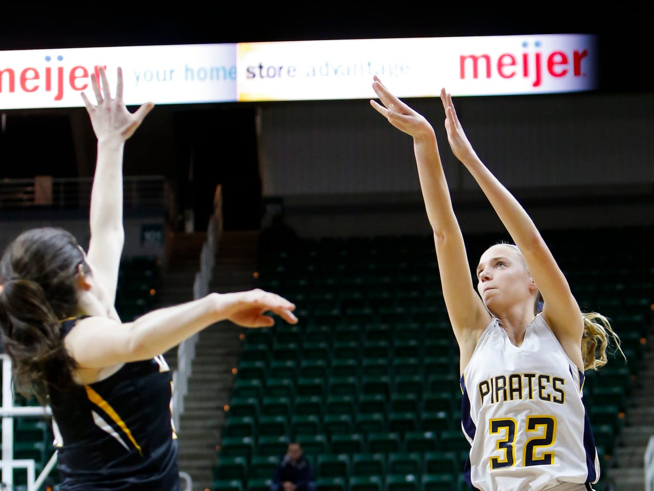 P-W's Emily Spitzley connects on a three-pointer against Maple City Glen Lake Thursday, March 16, 2017, during the Class B Semifinal at the Breslin in East Lansing. P-W won 64-51.