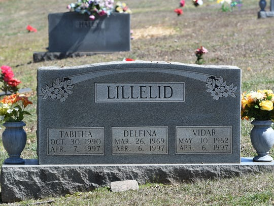 Flowers adorn the gravestone of Vidar, Delfina and