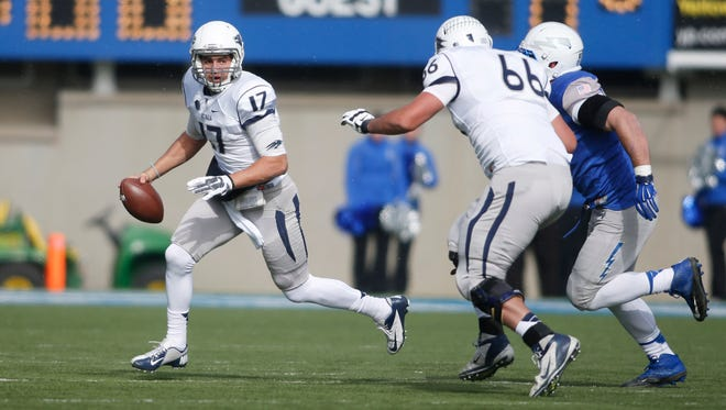 Nevada Wolf Pack quarterback Cody Fajardo (17) scrambles out of the pocket during the first half against the Air Force Falcons at Falcon Stadium.