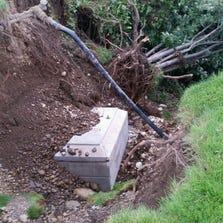 A vault holding a casket slides down a hill at the Fairmount Memorial Park in Spokane, Wash., Aug. 29, 2014.