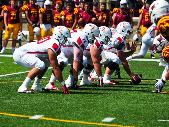 The Olivet College offensive line gets ready vs. St.