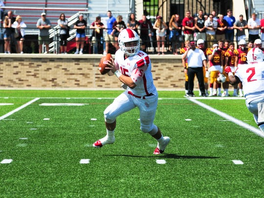 Olivet College quarterback Braden Black drops back