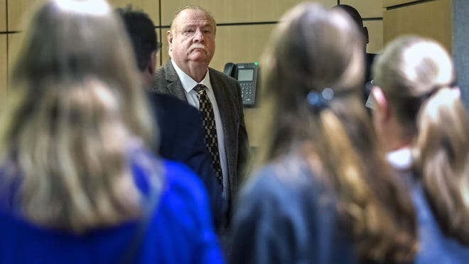 Carlton Nebergall looks at family members as he is led away after being found guilty of manslaughter Monday, March 16, 2020. Nebergall, a retired Palm Beach County sheriff's deputy, was charged with first-degree murder in the 2018 fatal shooting of his estranged son-in-law, Jacob Lodge.