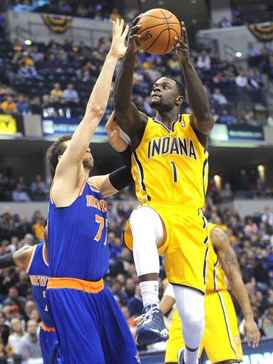 Lance Stephenson scores over Nicks defender Andrea Bargnani. The Pacers hosted New York in NBA action at Bankers Life Fieldhouse Thursday January 16, 2014.