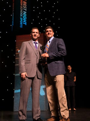 Joe Lang, a senior at Community School of Naples, accepts the award for the Naples Daily News offensive football award during the Southwest Florida Sports Awards at the Barbara B. Mann Performing Arts Center Wednesday, May 24, 2017 in Fort Myers, Fla. Lang would also win the Naples Daily News boys athlete of the year award.