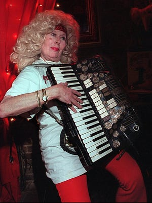 Betty Meyer, owner of Bullwinkle's, jams on her accordion in this 1997 file photo. She would encourage everyone to come up and sing a song or two with her and the rest of the players.