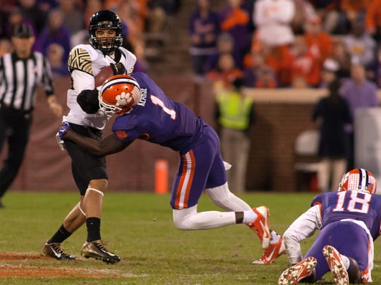 Wake Forest Demon Deacons wide receiver K.J. Brent (80) gets tackled by Clemson Tigers safety Jayron Kearse (1) after a catch during the third quarter at Clemson Memorial Stadium. Clemson defeated Wake Forest 33-13. Mandatory Credit: Jeremy Brevard-USA TODAY Sports