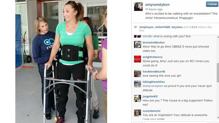 Amy Van Dyken-Rouen walks for the first time after her ATV accident.