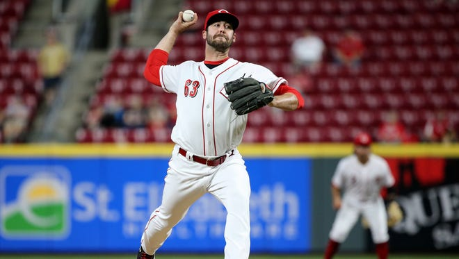 Cincinnati Reds relief pitcher Dylan Floro (63) delivers in the ninth inning during a National League baseball game between the Milwaukee Brewers and the Cincinnati Reds, Tuesday, May 1, 2018, at Great American Ball Park in Cincinnati. Milwaukee won 7-6