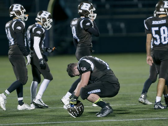 ER/Gananda's Alex Brothers feels the weight of the 40-30 loss to Bath at Sahlen's Stadium.