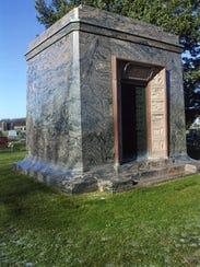 The rainbow granite mausoleum for Patrick Henry Alexander,