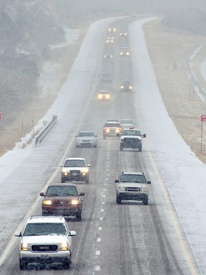 Motorists make their way through light snow and fog as they make their way on I-25 near Santa Fe, N.M. Tuesday, Jan. 29, 2013.  (AP Photo/The Santa Fe New Mexican, Clyde Mueller)