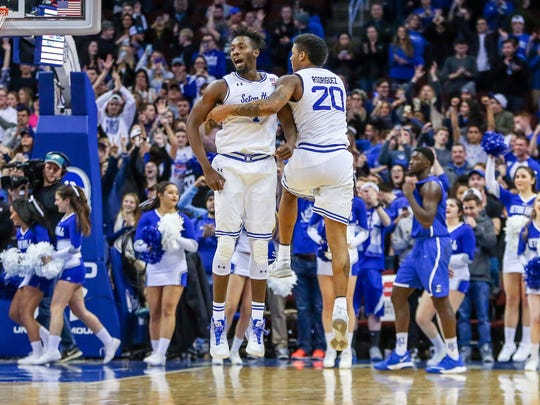 Seton Hall Pirates forward Michael Nzei (1) and forward Desi Rodriguez (20) celebrate after their game against the Creighton Bluejays.