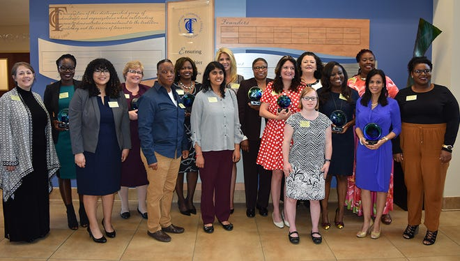 Women's History Month honorees with keynote speaker Suzanne Harrison on far left.