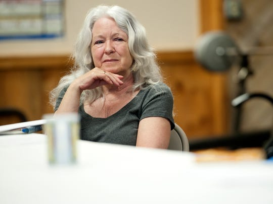 Leslie Bonnette of Shelburne listens as a fellow member of the Writers for Recovery group reads aloud at the Turning Point Center in Burlington on July 16.