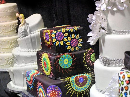 A traditional round, tiered cake can still be found at many wedding, but some couples are choosing to jazz up dessert. Pictured is a sampling of some of the selections of cakes presented by Brenda's Cakes and Catering during the Indianapolis Bride Expo, which took place Jan. 26.