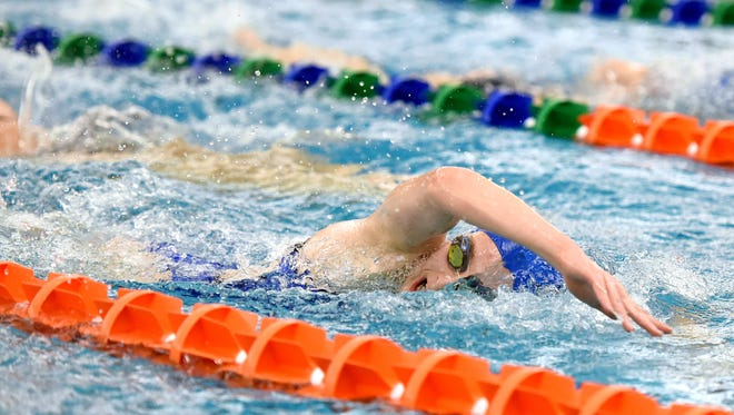 Corinne Pelzer swims laps during practice for the Sioux Falls Swim Team at the Midco Aquatic Center on Thursday.