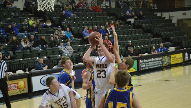 Sawyer Koch of Oconto goes up for a shot against Bonduel in the 6th annual Shawano Shootout at the Kress Center at UW-Green Bay. Oconto won 72-56.