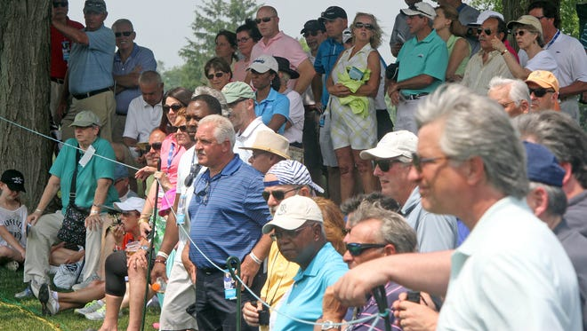 Spectators watch Michelle Wei on the 12th hole on day one of the KPMG Women's PGA Championship at Westchester Country Club in Harrison June 11, 2015.
