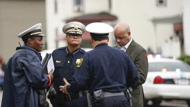 Cincinnati Police Chief Jeffrey Blackwell speaks with officers at the scene of Friday's shooting in Madisonville.