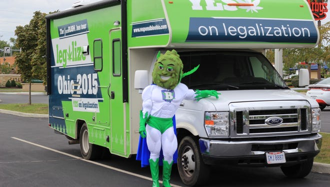 The ResponsibleOhio's new mascot Buddie poses with the promotional bus now traveling Ohio.