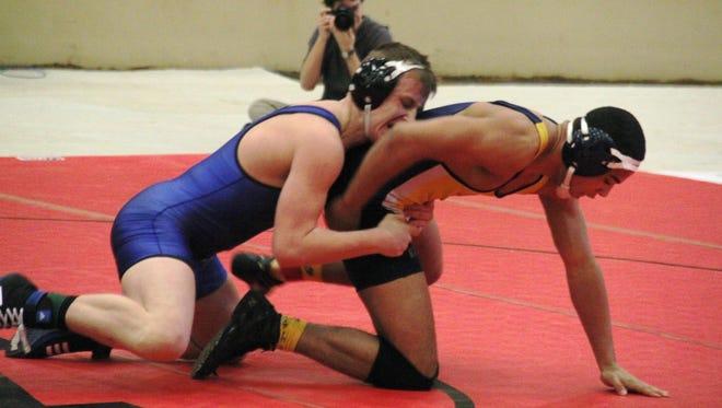 Returning 182-pound regional runner-up Casey Cornett, left, will lead a rebuilding Simon Kenton wrestling program. They start the season Dec. 5 at the Oldham County Super Duals.