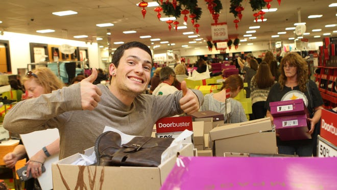 A shopper has some fun during Thanksgiving Day sales in Clarksville.