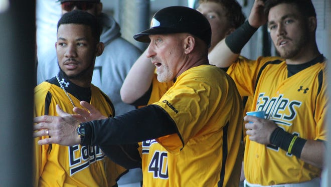 Southern Miss baseball coach Scott Berry talks with his players during Wednesday's game against Columbia at Pete Taylor Park.