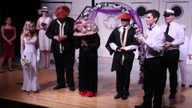 """The cast of """"Anything Goes"""" rehearses a wedding scene for the musical opening this weekend at West Muskingum High School."""