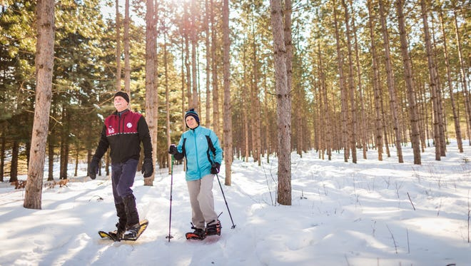 Snowshoeing is among the available activities at Schlitz Audubon Nature Center's Family Snow Day.